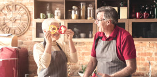 Older couple cooking fresh food